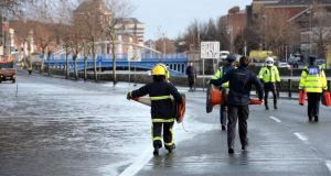Flooding in Dublin: firefighters and gardaí block off a submerged part of Wolfe Tone Quay in 2014. Photograph: Brenda Fitzsimons