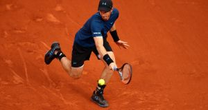Andy Murray of hits a backhand during the first round match against Andrey Kuznetsov of Russia on day three of the 2017 French Open at Roland Garros. Photo: Clive Brunskill/Getty Images)