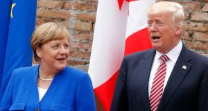 Angela Merkel and Donald Trump at last week's G7 summit: US press secretary Sean Spicer is seeking to downplay reports of tensions between the two leaders. Photograph:  Philippe Wojazer/AFP/Getty Images