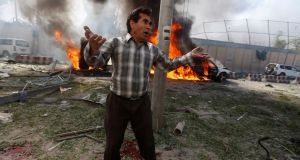 An Afghan man reacts at the site of a blast in Kabul, Afghanistan. Photograph: Reuters/Omar Sobhani