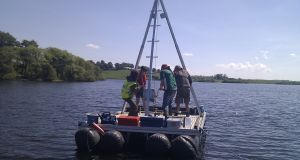 Lake sediment coring at Lough Muckno, Co Monaghan. The NUI Galway research team extracted a 10-meter sediment core to reconstruct long-term environmental change. Photograph: Karen Molloy, NUI Galway