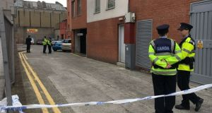 Gardaí at the scene of the shooting at Sheridan Court in Dublin city centre. Photograph: Sorcha Pollak