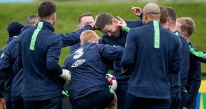 Republic of Ireland goalkeeper Colin Doyle receives some light-hearted attention from his team-mates. Photograph: Morgan Treacy/Inpho