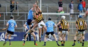 Kilkenny's Conor Doheny and Jason Cleere with Eoghan McHugh of Dublin. Photo: Tommy Dickson/Inpho