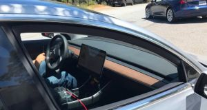 Tesla Model 3: test car seems to indicate the interior will feature a  big central screen, but with no conventional dash or dials.