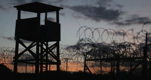 A watch tower in Camp X-Ray, the first detention facility to hold 'enemy combatants' at the US Naval Station on  in Guantanamo Bay, Cuba. Photograph: Joe Raedle/Getty Images