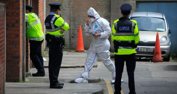 Gardaí at   Sheridan Court, Dorset Street where the body of  Michael Keogh, the latest victim of the Hutch-Kinahan feud, was found in an underground car park.  Photograph: Gareth Chaney Collins