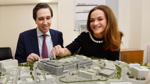 Minister for Health Simon Harris and National Maternity Hospital (NMH) master Rhona Mahony with a model of the proposed new NMH at the St Vincent's hospital campus in Dublin. Photograph: Cyril Byrne