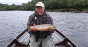 John Young with his 1.5kg Lough Mask trout.