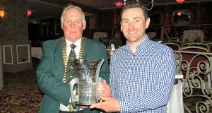 ITFFA president Albert Berry presenting the cup to Darren Maguire after his victory at the 84th National Championships at Lough Owel.