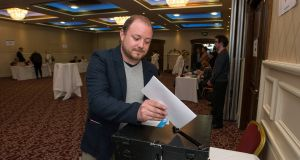 Fine Gael party member Frankie Mulqueen casts his vote in the leadership election on Monday night in the Red Cow hotel in Dublin. Photograph: Dave Meehan