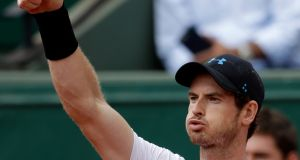 Britain's Andy Murray thumbs up as he plays Slovakia's Martin Klizan during their second round match of the French Open tennis tournament at the Roland Garros stadium, Thursday, June 1, 2017 in Paris. (AP Photo/Petr David Josek)