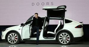 Elon Musk demonstrates the falcon wing doors on the Tesla Model X Crossover. Musk warned the Danish government  electric car sales would be hit when it dropped tax breaks. Photograph: Justin Sullivan/Getty Images