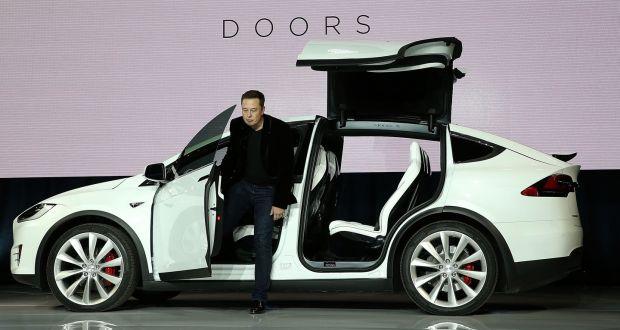 Elon Musk Demonstrates The Falcon Wing Doors On Tesla Model X Crossover Warned
