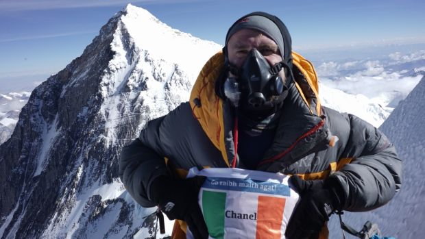 German Ronny the Rocket on top of Lhotse with Everest in background and with his tricolour for his long time supporter Chanel from Clare, wish we had also tried to summit on the 21st when there were views!