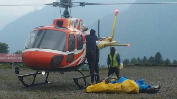 Bodies of climbers which were recovered from mountain being off loaded at Lukla airport.