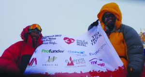 14 time Everest summiteer Dorjee and myself on the summit with The Irish Times logo.