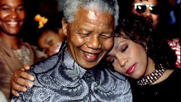 South African president Nelson Mandela and Whitney Houston smile for photographers in Johannesburg in this November 10th, 1994. Photograph: Juda Ngwenya/Reuters