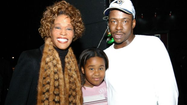 Whitney Houston with her daughter Bobbi Kristina Brown and husband Bobby Brown. Photograph: Frank Mullen/WireImage