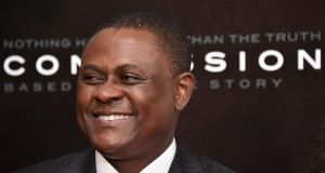 "Dr Bennet Omalu: the forensic pathologist turned the pugilist moniker ""punch drunk"" into chronic traumatic encephalopathy (CTE), following the autopsy of  Pittsburgh Steelers offensive lineman Mike Webster's brain. Photograph: Mike Coppola/Getty Images"