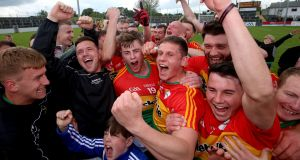 Carlow celebrate their victory over Wexford in the first round of the Leinster championship at Netwatch Cullen Park.  Photograph: Tommy Dickson/Inpho