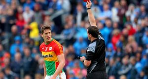 Carlow midfielder  Brendan Murphy  receives a red card following a second yellow from referee Sean Hurson during the Leinster SFC quarter-final against Dublin  at O'Moore Park in Portlaoise. Photograph:  James Crombie/Inpho