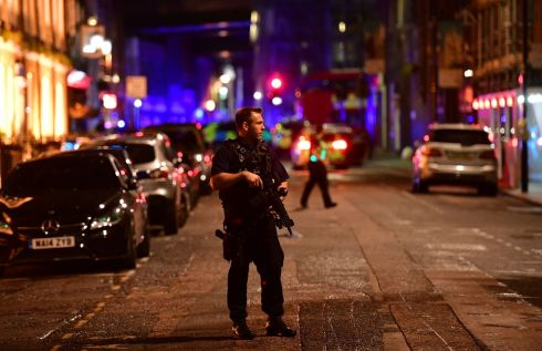 Armed police on Borough High Street in London. Photograph: Dominic Lipinski/PA
