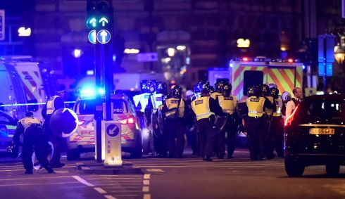Police attend to an incident on London Bridge. Photograph: Hannah McKay/Reuters