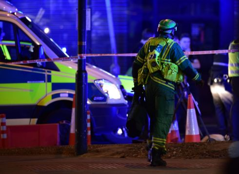 A paramedic rushes to the scene in London.