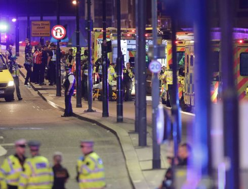 Emergency personnel tend to wounded on London Bridge. Photograph: Yui Mok/PA