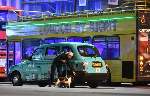 Police sniffer dogs on London Bridge.