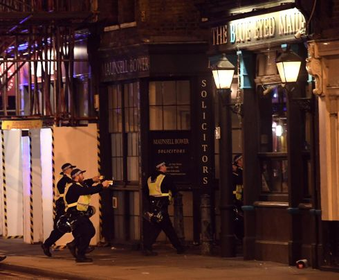 Armed police raid The Blue Eyed Maid in Borough High Street. Photograph: Carl Court/Getty Images