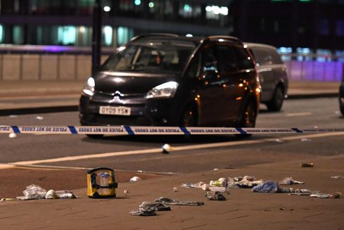 Debris and abandoned cars at the scene of the terror attack. Photograph: Chris J Ratcliffe/AFP