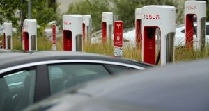 Tesla vehicles charge at a Tesla Supercharger station on the Qualcomm campus in San Diego, California.  Photograph: Mike Blake/Reuters