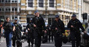 Armed police officers patrol on Borough High Street in London on Sunday, following the terror attack on Saturday night.   Photograph: Chris J Ratcliffe/AFP/Getty Images