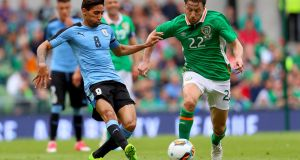 The Republic of Ireland's Harry Arter takes on  Uruguay's Jonathan Urretaviscaya at the Aviva Stadium. Photograph: Oisin Keniry/Inpho
