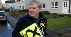 The SNP's deputy leader, Angus Robertson, campaigning in Elgin, Moray, Scotland. Photograph: Russell Cheyne/Reuters