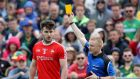 Louth's Patrick Reilly is shown a yellow during his side's defeat to Meath, a result which saw them drop into the qualifiers where they will play Longford. Photograph: Bryan Keane/Inpho