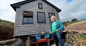 Breanndán Ó Beaglaoich outside the house he built on a truck in Baile na bPoc. Locals in the west Kerry Gaeltacht are finding it almost impossible to get planning permission. Photograph: Domnick Walsh