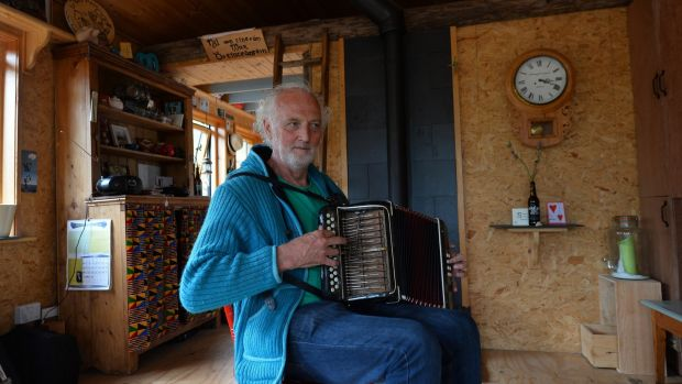 Musician Breanndán Ó Beaglaoich in the tigín he built on a truck chassis. Kerry County Council have asked him to move his home off the site in Baile Na bPoc in west Kerry. Photograph: Domnick Walsh