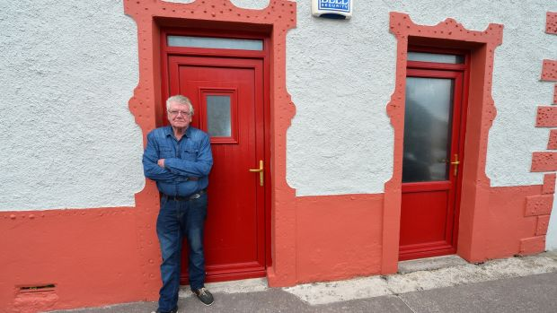 Artist Tomás Ó Cíobháin outside the old post office he bought in Ballyferriter after he was refused planning permission to build in his home in Gráig, west Kerry. Photograph: Domnick Walsh