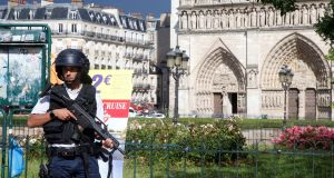 French police stand at the scene of a shooting incident near the Notre Dame Cathedral in Paris, France. Photograph: Charles Platiau/Reuters