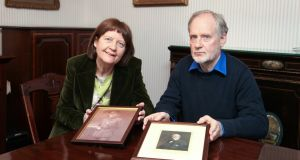 Mary and John Green, great grandchildren of John Redmond, with photographs of Willie and John Redmond. Photograph: Joanne O'Brien