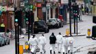 Police forensic officers work on Borough High Street following the terror attack. Photograph: Justin Tallis/AFP/Getty