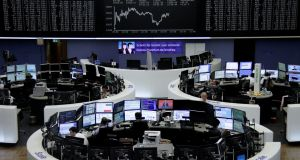 Traders work in front of the German share price index in Frankfurt, Germany. Photograph: Reuters