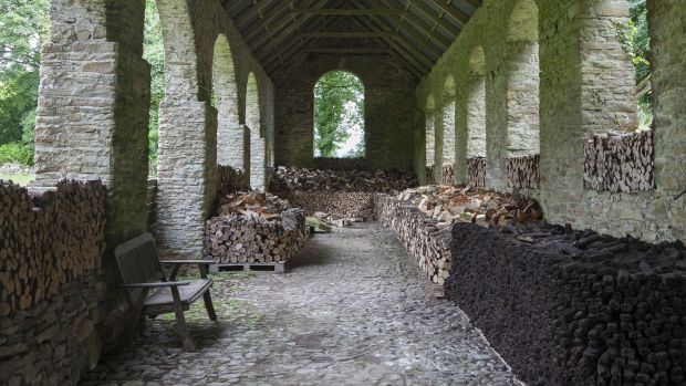 The turf barn with wood stacks at Roundwood House, Mountrath, Co Laois. Photograph: James Fennell