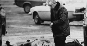 'One of them seemed to be breathing': Fr Alec Reid gives last rites to a soldier killed in west Belfast in 1988