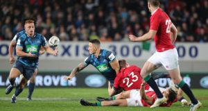 Blues' Sonny Bill Williams offloads to Ihaia West to set up the winning try in their clash with the Lions at Eden Park. Photo: Peter Meecham/Inpho