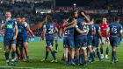 Blues players celebrate after beating the British and Irish Lions in their clash at Eden Park. Photo: David Rowland/EPA