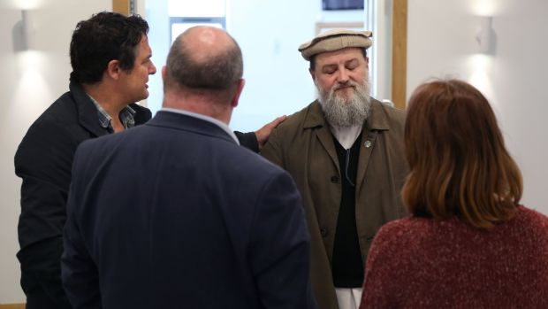 Imam Ibrahim Ahmad Noonan (centre) of the Masjid Maryam mosque in Galway where rocks were thrown through the windows on Monday. Photograph: Joe O'Shaughnessy